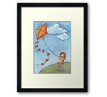 Flying a kite Framed Print