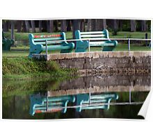 Bench at waters edge Poster
