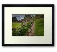 Crooked fence with shadow Framed Print
