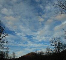 cloudy sky on the mountain by saiberiac