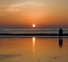 Sunrise On The Beach by Joe Norman