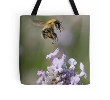 Bumble bee taking off from Lavender Tote Bag