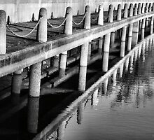 Pier Patterns Reflections in Black and White by M Sylvia Chaume