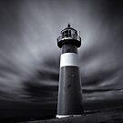 Lighthouse at the Dutch Coast by Joel Tjintjelaar