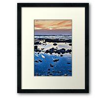 calm yellow sunset over rocky beach Framed Print