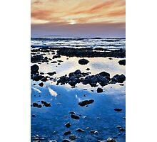 calm yellow sunset over rocky beach Photographic Print