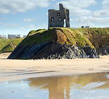 castle and beach with beautiful reflection of the clouds by morrbyte