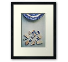 Picking up the broken pieces. Framed Print