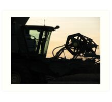Silhouetted combine's header Art Print