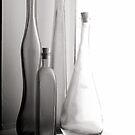 bottles black and white by jon  daly