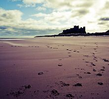 Footsteps In The Sand (Bamburgh) by Ritchie Coatsworth