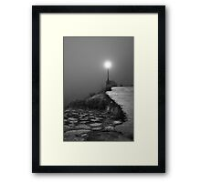 A light in the dark Framed Print
