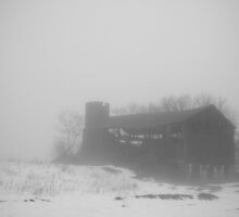 Old barn in fog with snow by Mike  Wood