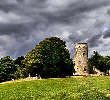 Gothic Tower below Grey Clouds by Karen  Betts