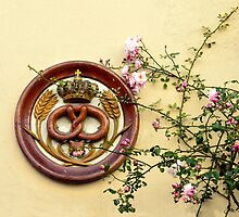 Crowned Pretzel Sign and Roses by Catherine Sherman