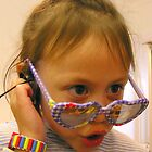 Cute young girl wearing kids sunglasses by Dave P