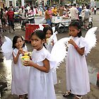 Young angels at Mandaue City market, Philippines by Dave P