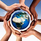 Multiracial hands making a circle together around the world globe art photo print by ArtNudePhotos