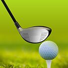 Golf ball and driver on green grass by Bruno Beach