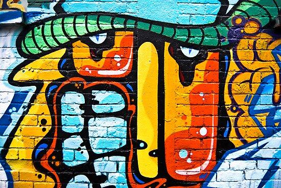 Abstract graffiti on the brick wall by yurix