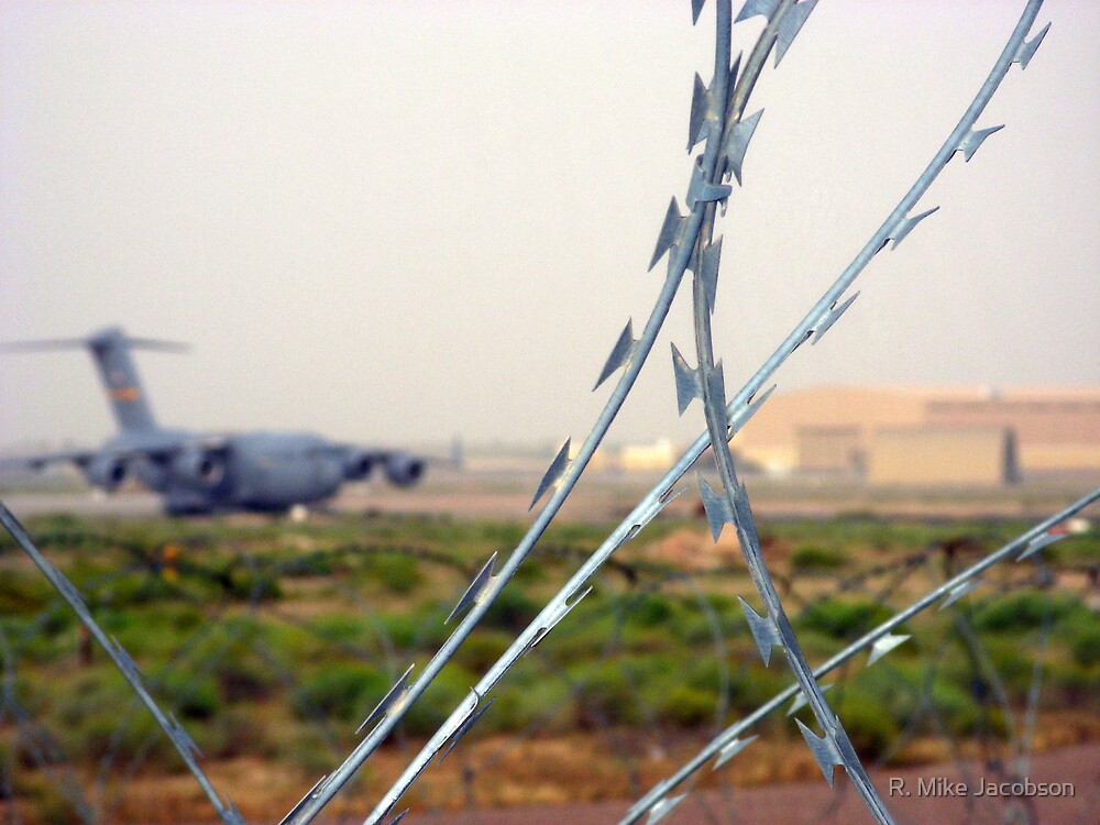 Behind the Wire by R. Mike Jacobson