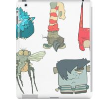 Vector set of illustrations cartoon cute monsters or aliens with claws and fangs iPad Case/Skin