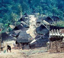 Akha village scene by John Spies