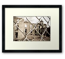 Abandoned Building through Fence Framed Print