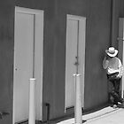 Man against wall by John Fleming
