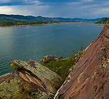 Rock Cliff, reflective water, and a perfect shady sky in Horsetooth by Roschetzky