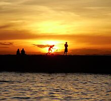 Silhouetted locals at sunset, Salvador, Brazil by Stunningstills