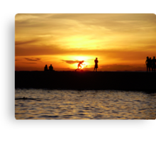 Silhouetted locals at sunset, Salvador, Brazil Canvas Print