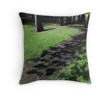 A flower carpeted path for the shadows Throw Pillow