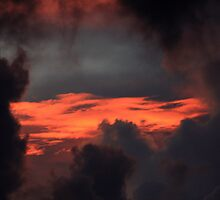 Sunset In The Clouds by Virginia N. Fred