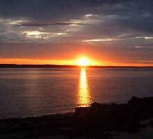 sun setting in skerries by valjones