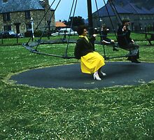 Swings And Roundabouts (circa 1960) by Mike Oxley