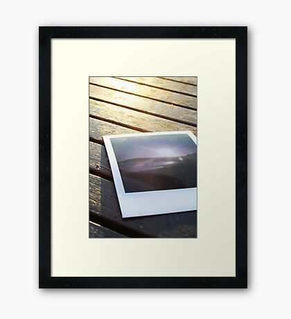 Polaroid on the deck Framed Print