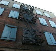 Rusted fire escapes on an old building...... by DonnaMoore
