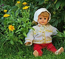 Doll in the garden by Paola Svensson
