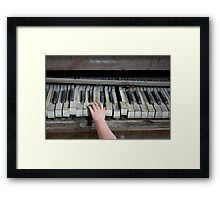 Creepy Piano Baby Framed Print