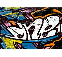 Abstract graffiti detail on the brick wall Photographic Print