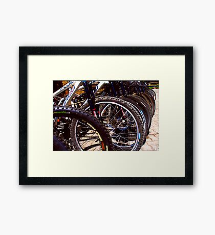 Lined up Bikes Framed Print