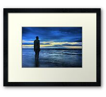 Statues on the beach Framed Print