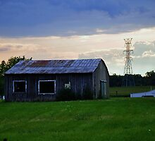Old gray barn with rusty roof by mltrue