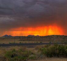 Rainband sunset by NikonLarry