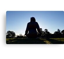Cute mysterious man meditating in nature Canvas Print