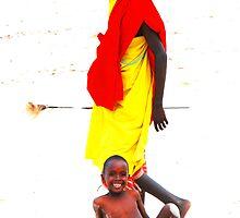 Child on beach by Tony Hadfield