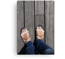 female legs in sandals Canvas Print