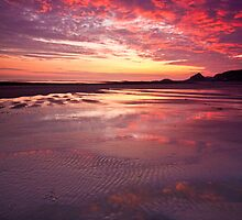 Clouds on fire at St. Ouen's Beach by Zoe Power