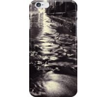 Rain water flowing on a cobblestone street in Helsinki iPhone Case/Skin